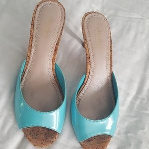 Turquoise patent leather shoe w/cork heel.